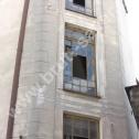 Wzmocnienie popękanej ściany i naroży w kamienicy z wykorzystaniem profili śrubowych Brutt Saver.