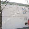 Wzmocnienie popękanych ścian hali produkcyjnej z zastosowaniem Brutt Technologies.