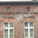Wzmocnienie uszkodzonych nadproży ceglanych w budynku mieszkalnym z wykorzystaniem profili spiralnych firmy Brutt Saver.