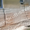 Naprawa muru. Saver Profile zamontowane w popękanym murze pod otworami okiennymi.